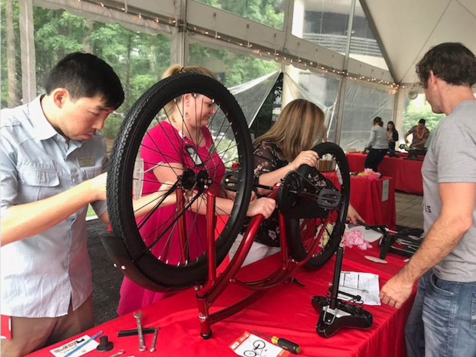 Staff Comes Together to Build Bikes for Community Partners