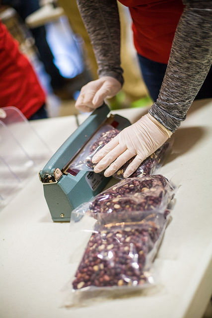 20 Support Center Staff Package One Ton of Food at Midwest Food Bank