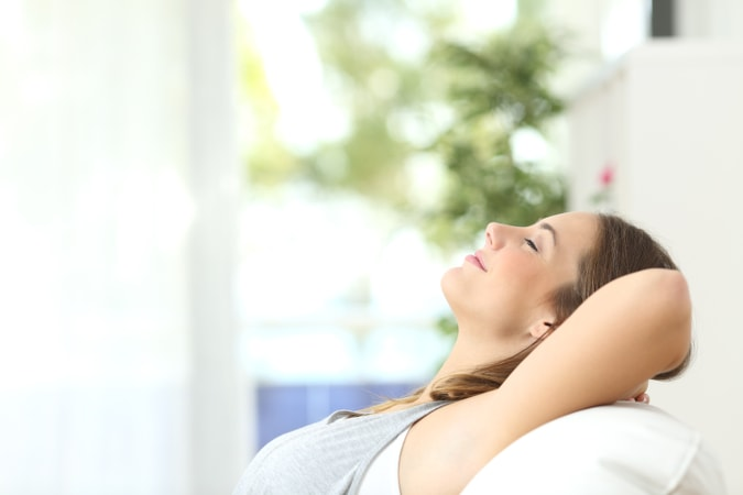 Woman Breathes Good Indoor Air Quality