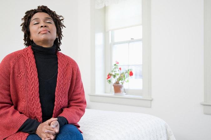 A woman breathing clean air