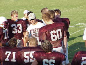 Coach and football players.