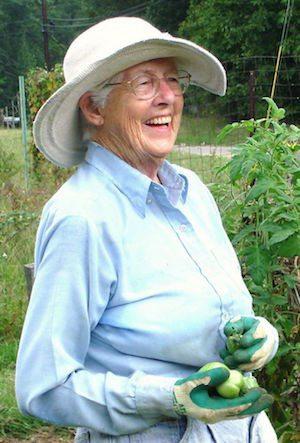 A happy elderly woman in her garden