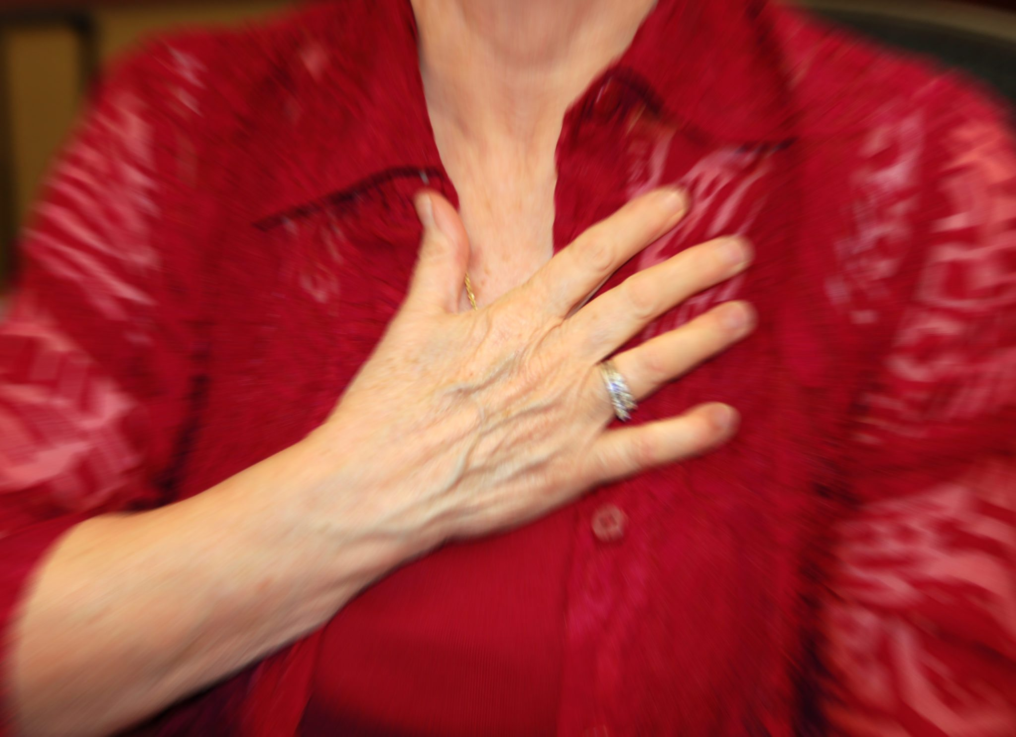 Woman placing hand over her heart