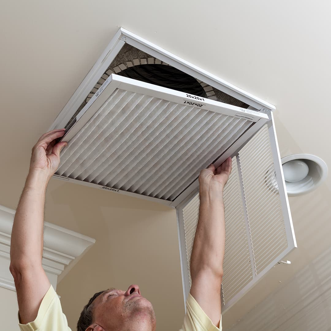 man changing air filter