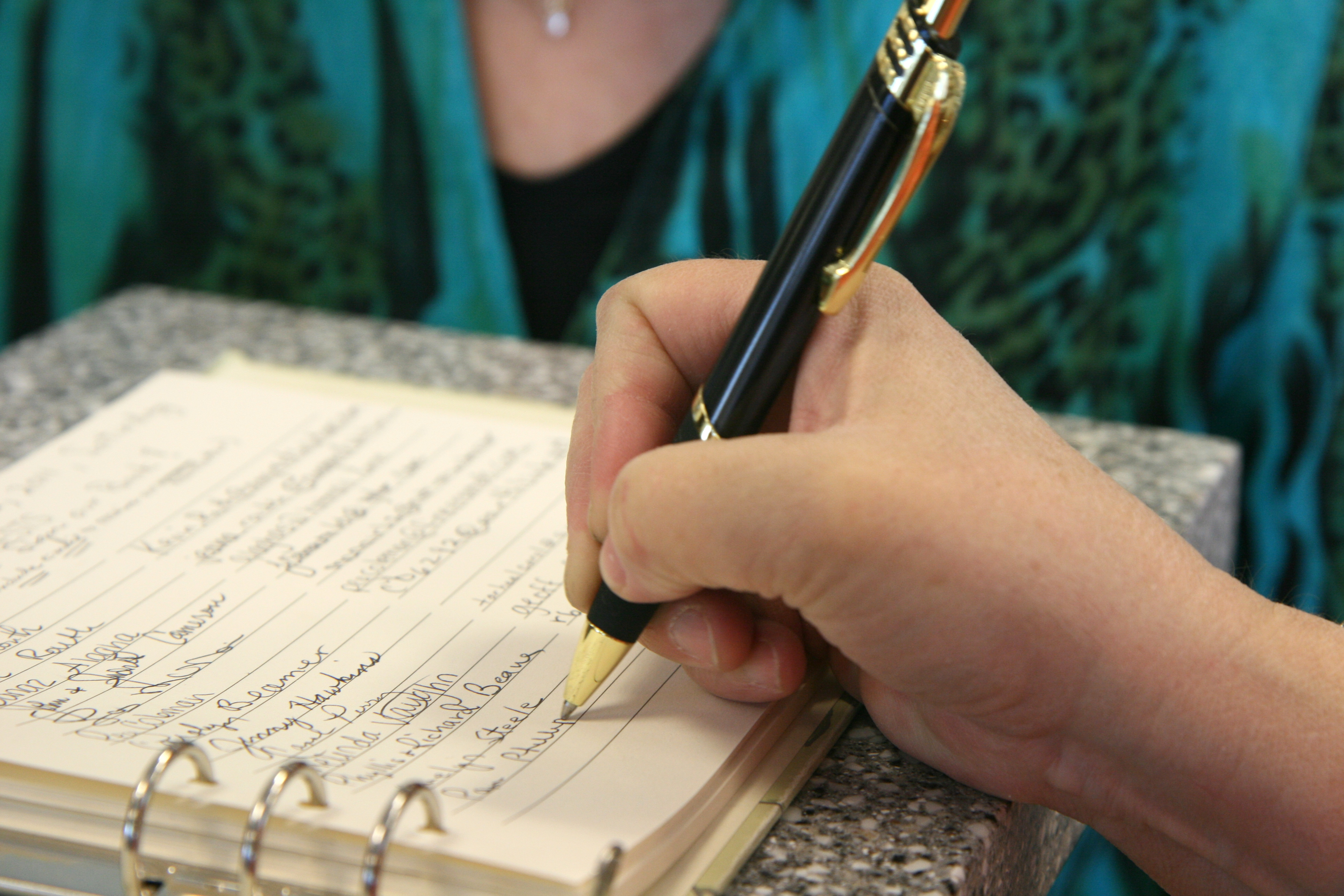 signing a guestbook at funeral