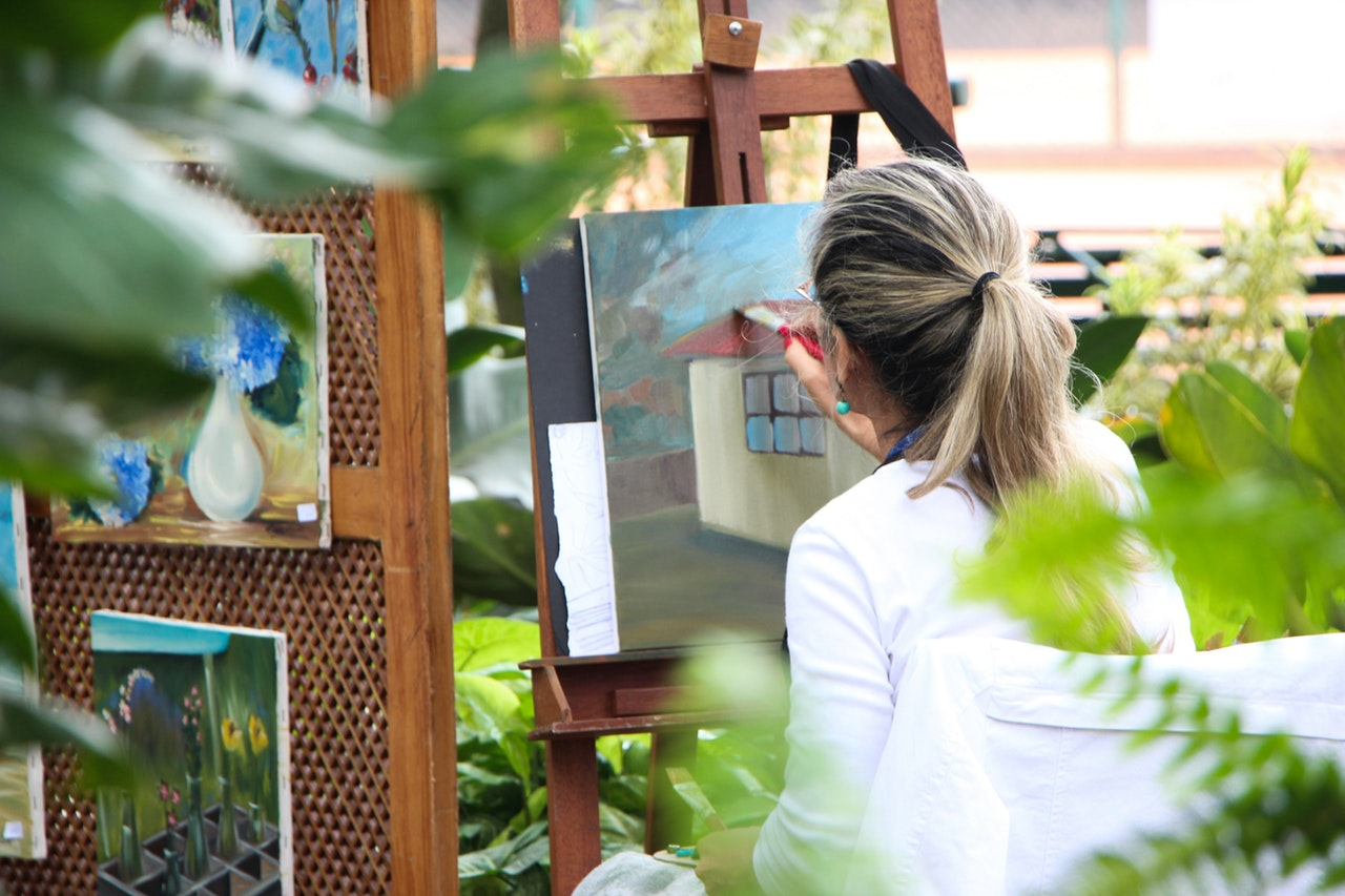 Woman painting in a garden