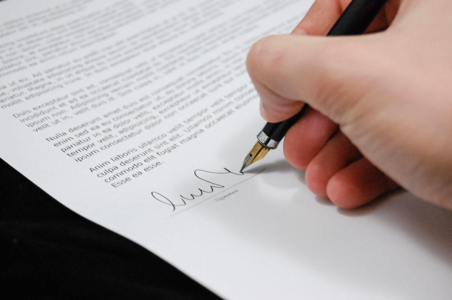 Person signing legal document
