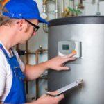 Plumber Evaluating Boiler