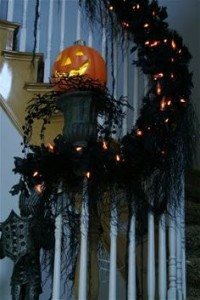 Black garland on stairway and mantle for Halloween